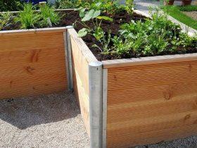 build a waist high raised bed garden https://organicgardeningeek.com
