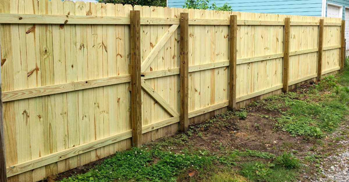 Build Appropriate Fencing  - building fence for dogs - how to discourage dogs from digging https://organicgardeningeek.com